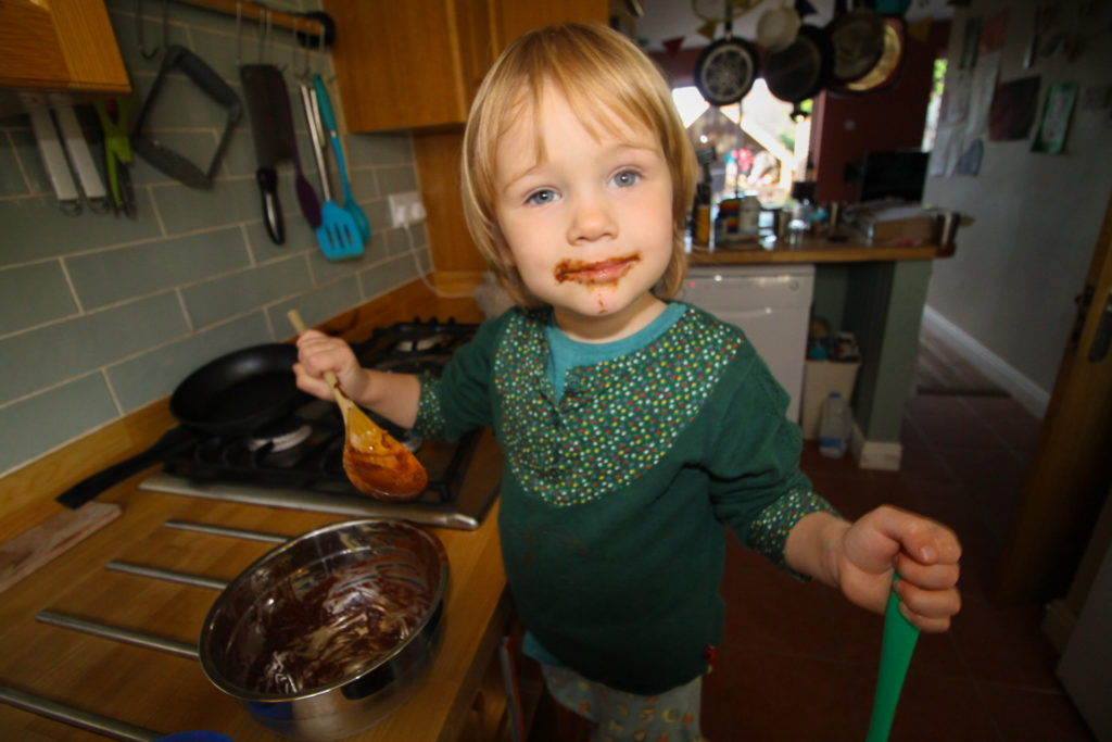 Daughter mixing ingredients for nut butter cups